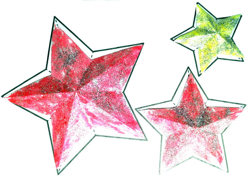 Manualidades con niños - purpurina por toda la casa - En la imagen, unas estrellas de papel con purpurina.